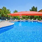 Relax in our outdoor swimming pool and jacuzzi