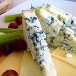 Assorted cheese with grapes and celery stick