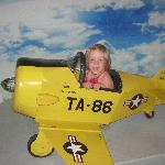 My youngest in the tiny plane.