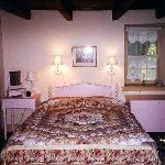 The Jenny Lind room with its queen spool bed and puffy comforter creates a romantic get away.