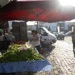 Vegetables being bought for restaurant fresh from the market opposite