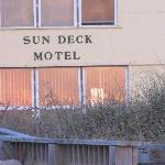 View of the SunDeck from the beach at sunrise.