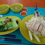 Chicken rice set includes soup and chile sauce