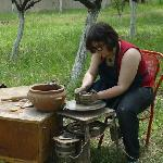 teaching how to work on a potter's whell