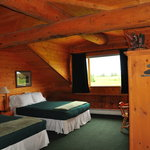 isn't this the coziest room ever???  look at the logs in the ceiling!!