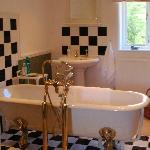 Ensuite bathroom with roll-top bath.