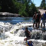 Jumping in the rapids at Old Pinawa Dam