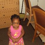 Our daughter near the room cupboard