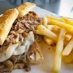 This Provolone cheese steak is busting at the seams. Even the fries can't keep their fingers off