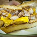 Grace serves up a freshly grilled chicken breast sandwich with goo-rrific American cheese.