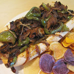 hilly Cheesesteak: thinly sliced ribeye, grilled with onions, green peppers and melted American