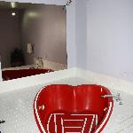 heart shaped jacuzzi tub in room