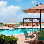 The outdoor pool is adjacent to the hotel's fitness center and features a spacious, landscaped s