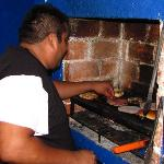 Jorge creates some special burgers at The Burger House...well kiosk