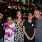 The owners Astrid and her husband (both in black) w/ us