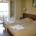 Room 6 sleeping area, also has seating,sink and bathroom
