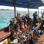 A family dive in the beautiful waters off Karafuu