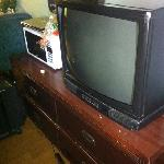 tv and furniture. VERY dusty behind, color is bad in upper lefthand corner of tv