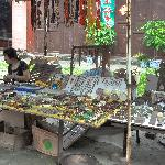 flea market inside the walls by the gate...old stuff for sale, Mao badges, coins, jade and momen
