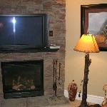 Unit #509- living room fireplace & TV