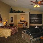 King Tee-Pee Bed, Desk, Jacuzzi & Living Room Areas