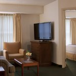 Our one-bedroom suites feature a spacious living room, complete with a flat-screen, cable TV, a