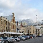 The nearby Salamanca harbourside area with impressive view of snow covered Mt Wellington backdro