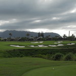 You can go for the green (far right) on the short par-4 14th, but anything right swims with the