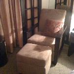 The comfy chair next to the bed