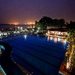 Pool and waterslide with view of harbour at night