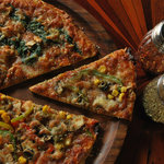 half and half pizza-pizza spinachi and corn and capsicum delight