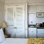 New shutters that hide a closet and a wet bar!