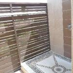 Outdoor shower with see-through wall