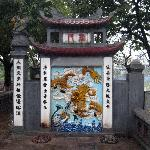 Gate Mural in front of bridge leading to the temple