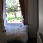 The First Door is the Main door and teh one touching the window is the Bathroom Door. The space