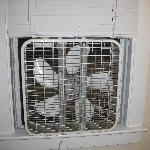 dusty fan in the window