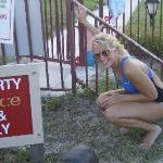 Resident turtle & my beautiful daughter with pool, etc. in background
