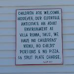 Sign outside Villa Roma discouraging families with children.
