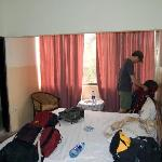 My husband inside our hotel room. The mess is ours!