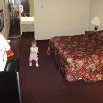 Clean good sized room. Note the design of the rooms with the part bathroom located in the actual