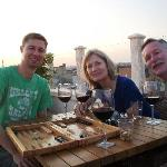 Playing backgammon, enjoying complimentary wine on the roof of the hotel