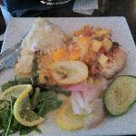 Swordfish covered in a mango mandarin salsa served with garlic mashed potatoes.