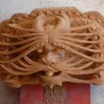 Visit the wood carving street in nearby QiongHai