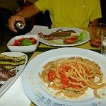 Spaghetti, grilled beef, grilled vegetables, and tomatoe salad.