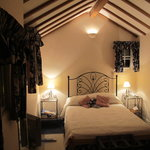 Our room - small but well decorated and comfortable.  See following picture for the steps you ha