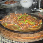 sizzling chicken in a smoking hot plate...