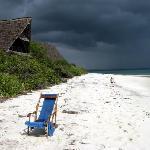 White beach, dark skies