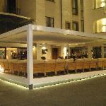 the hotel and the outdoor seating