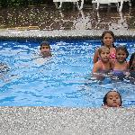 My kids swimming with some of their new Costa Rican friends