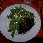 Blackened salmon on argula salad